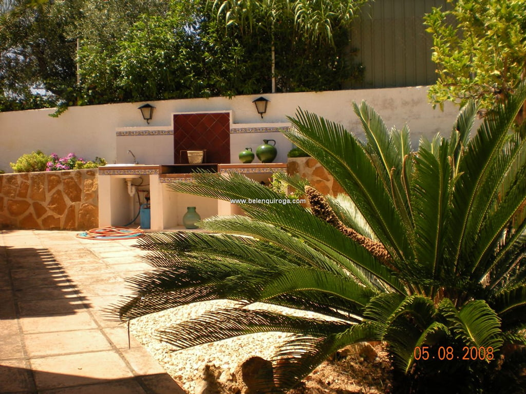 Terraza y jardin belen quiroga j x for Jardin belen villa ballester