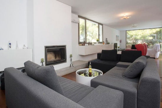 Sofa con chimenea Aguila Rent a Villa