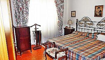 El dormitorio principal de la villa Marinabay Homes
