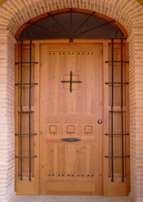 puerta-entrada-estilo-rustico-carpinteria-fusta-590x835