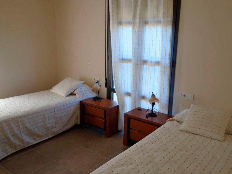 Uno de los dormitorios Casa Nova Villas
