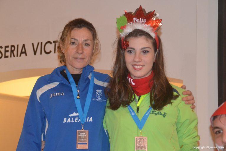 Mayca Sala and Naila Pérez on the podium
