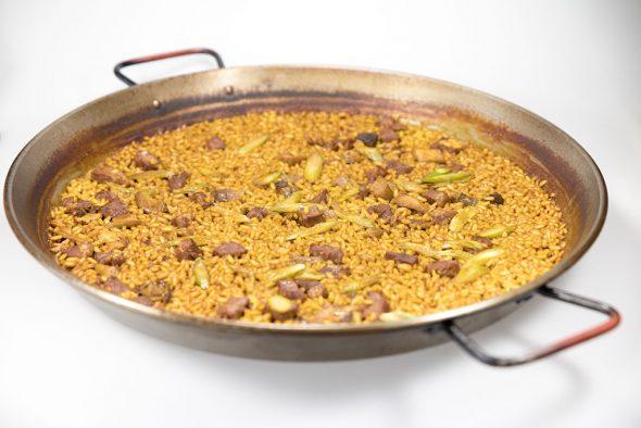 Paella pluma ibérica boletus y trufa Restaurante Noray