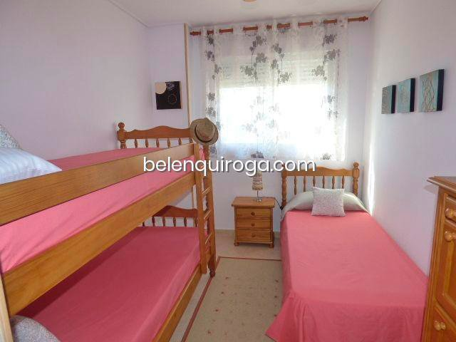 Dormitorio con tres camas Inmobiliaria Belen Quiroga