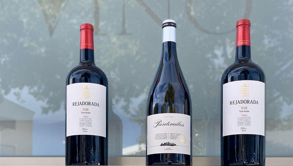 Disegna tre bottiglie di vino - Casa del Vino