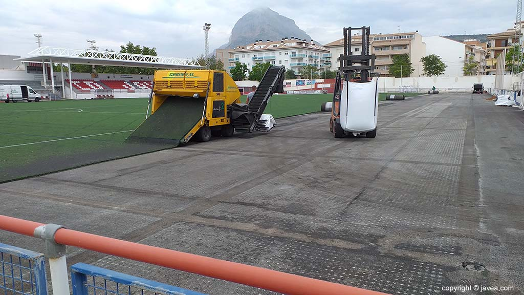 Machines removing grass from the soccer field