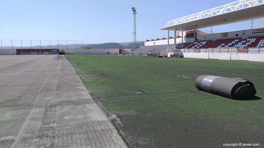 Replacing the grass of the football field