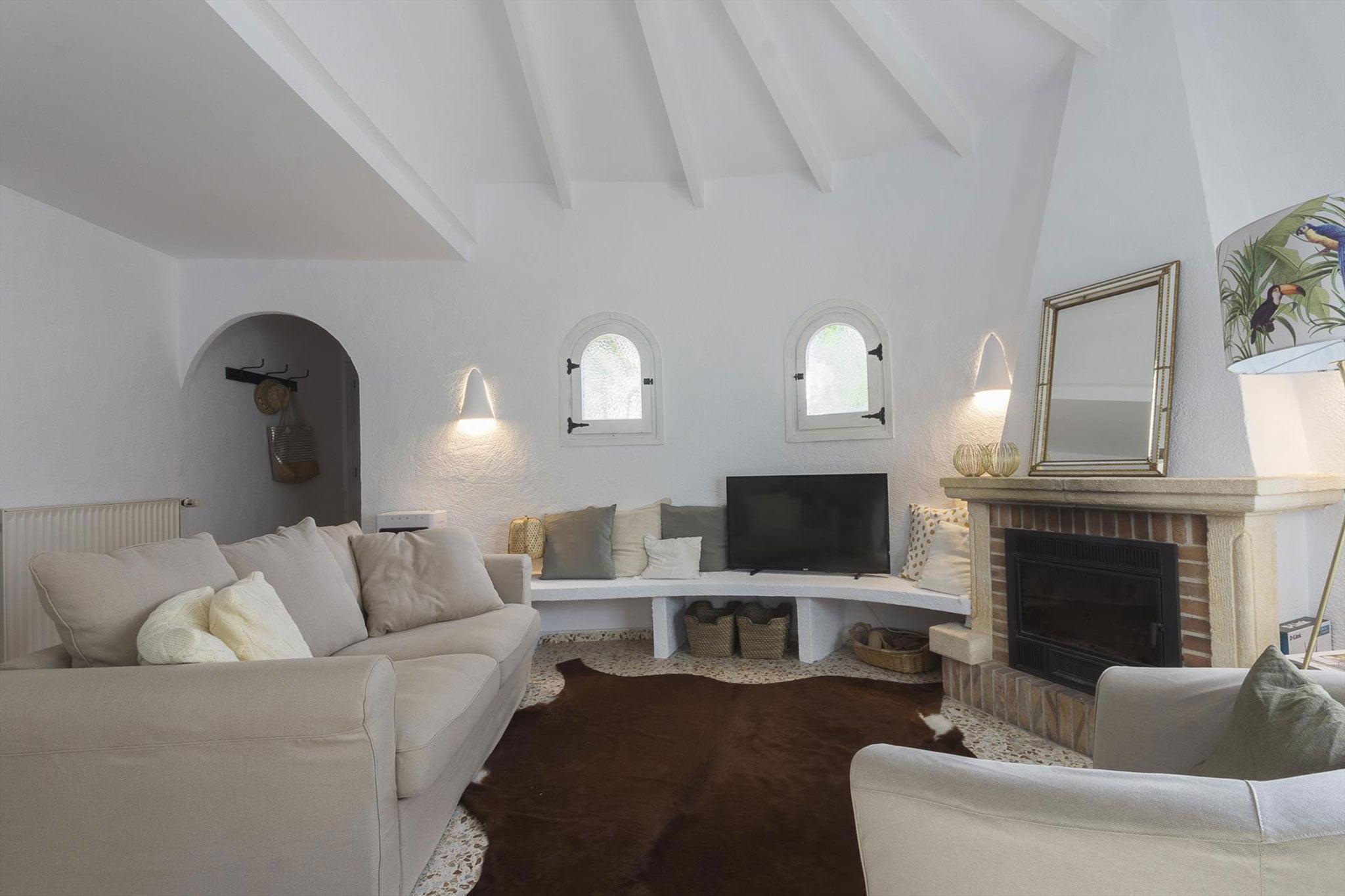 Salón de una casa de vacaciones para cinco personas en Jávea – MMC Property Services
