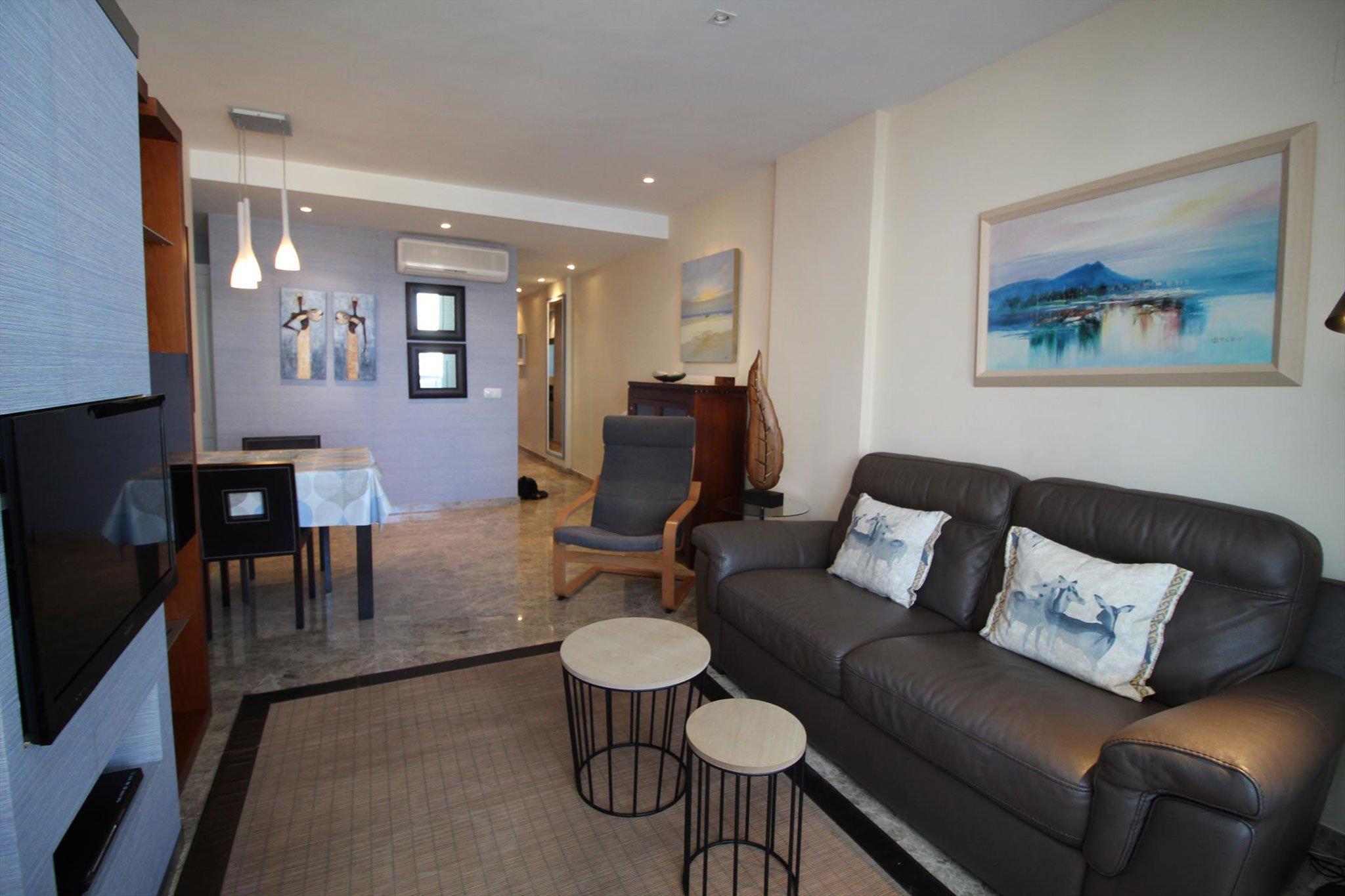 Salón comedor de un apartamento de vacaciones para cinco personas en Jávea – MMC Property Serivces