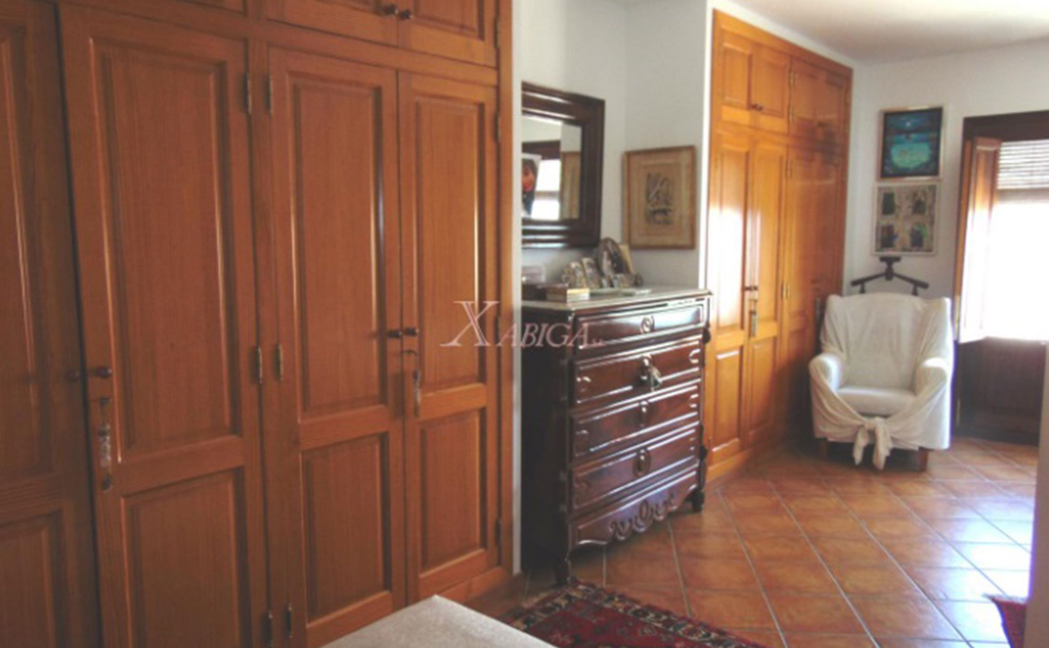 Dormitorio de una casa de pueblo en venta en el Puerto de Jávea – Xabiga Inmobiliaria