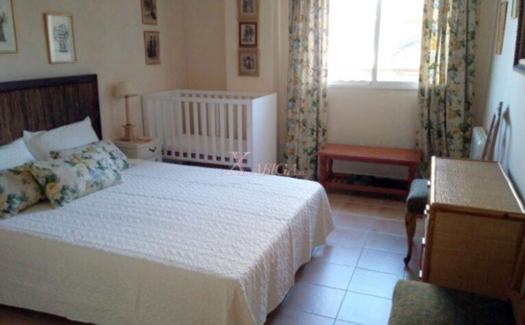 Dormitorio de un apartamento tríplex en Jávea - Xabiga Inmobiliaria
