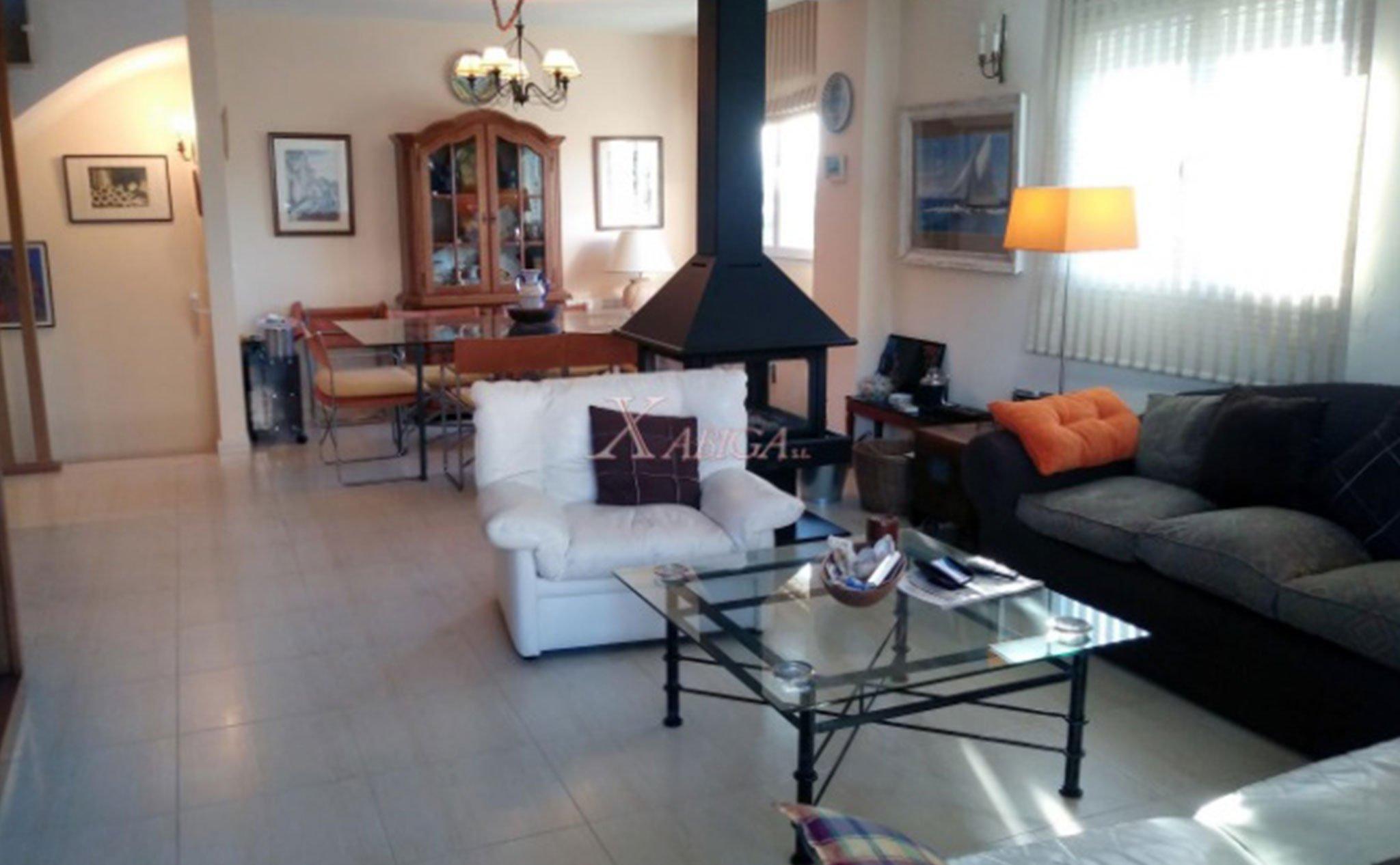 Salón de un apartamento tríplex en Jávea – Xabiga Inmobiliaria