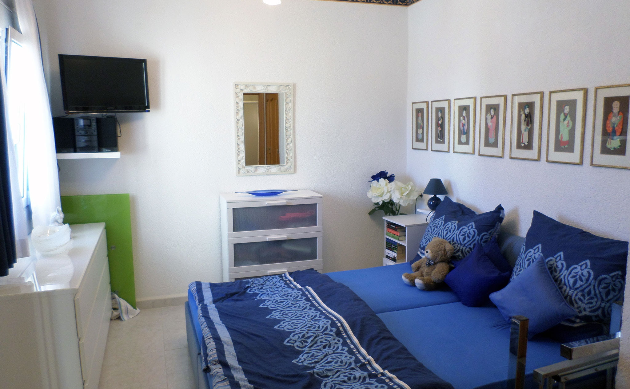Dormitorio de una villa en venta junto al campo de golf La Sella – Promociones Denia, S.L.