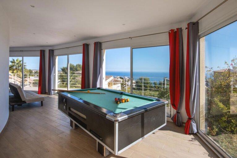 Sala de billar de una casa de alquiler de vacaciones en Benitachell - Aguila Rent a Villa