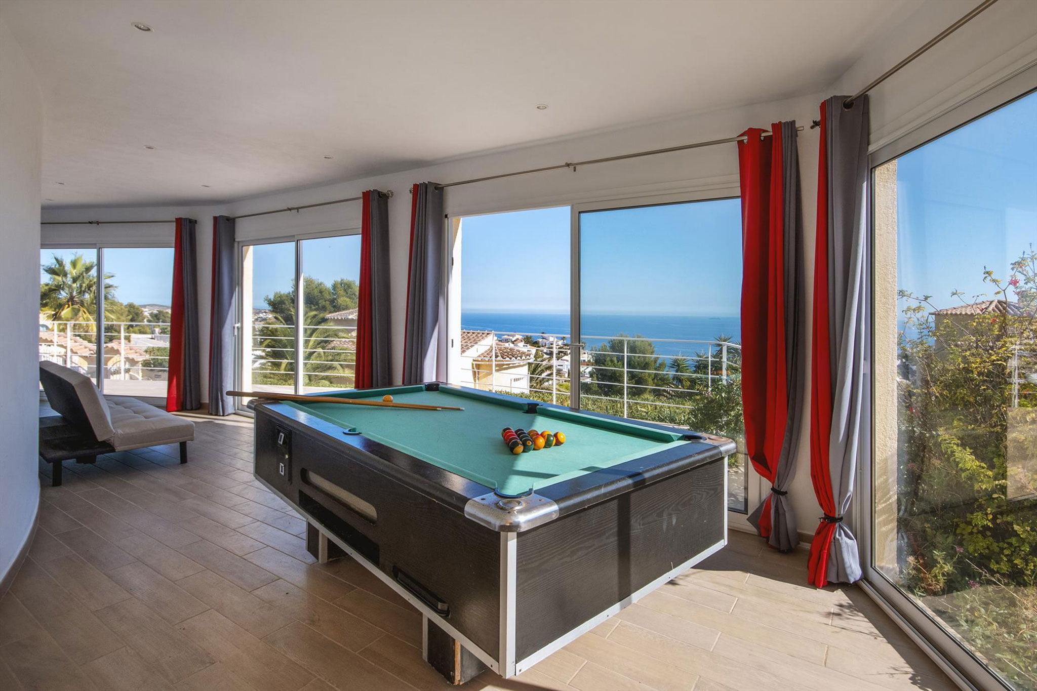 Sala de billar de una casa de alquiler de vacaciones en Benitachell – Aguila Rent a Villa