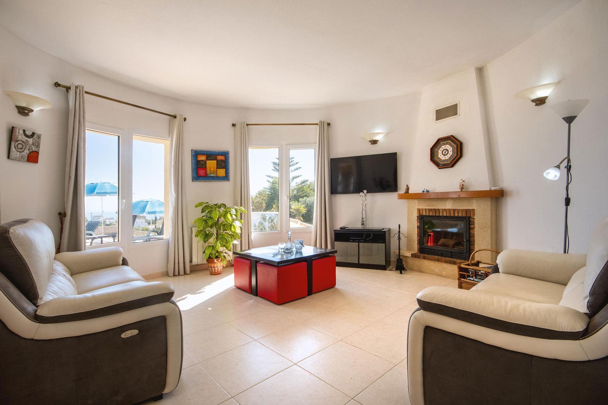 Salón de una casa de alquiler de vacaciones en Benitachell – Aguila Rent a Villa