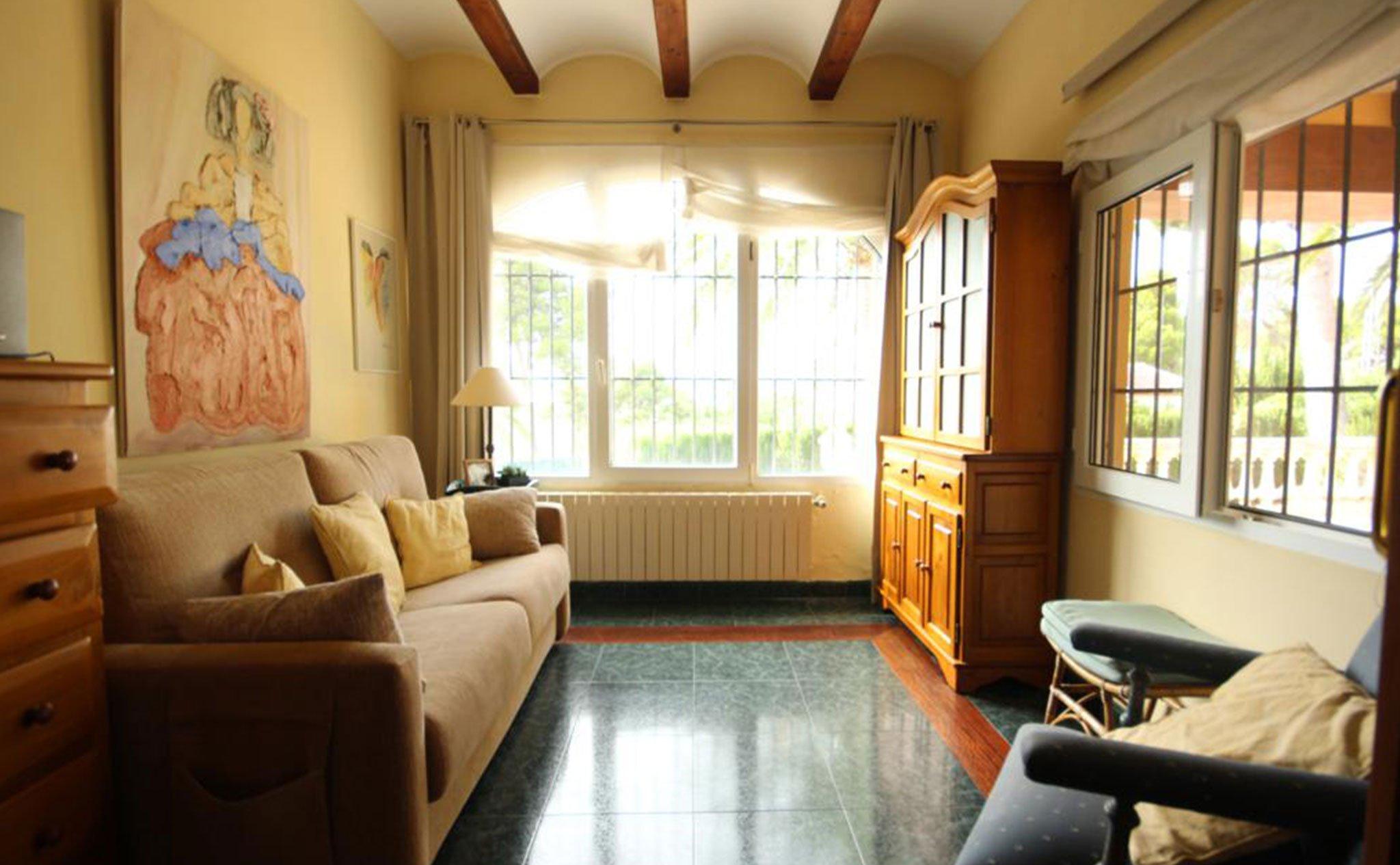 Salón de un chalet en venta en la zona Tosalet de Jávea – Atina Inmobiliaria