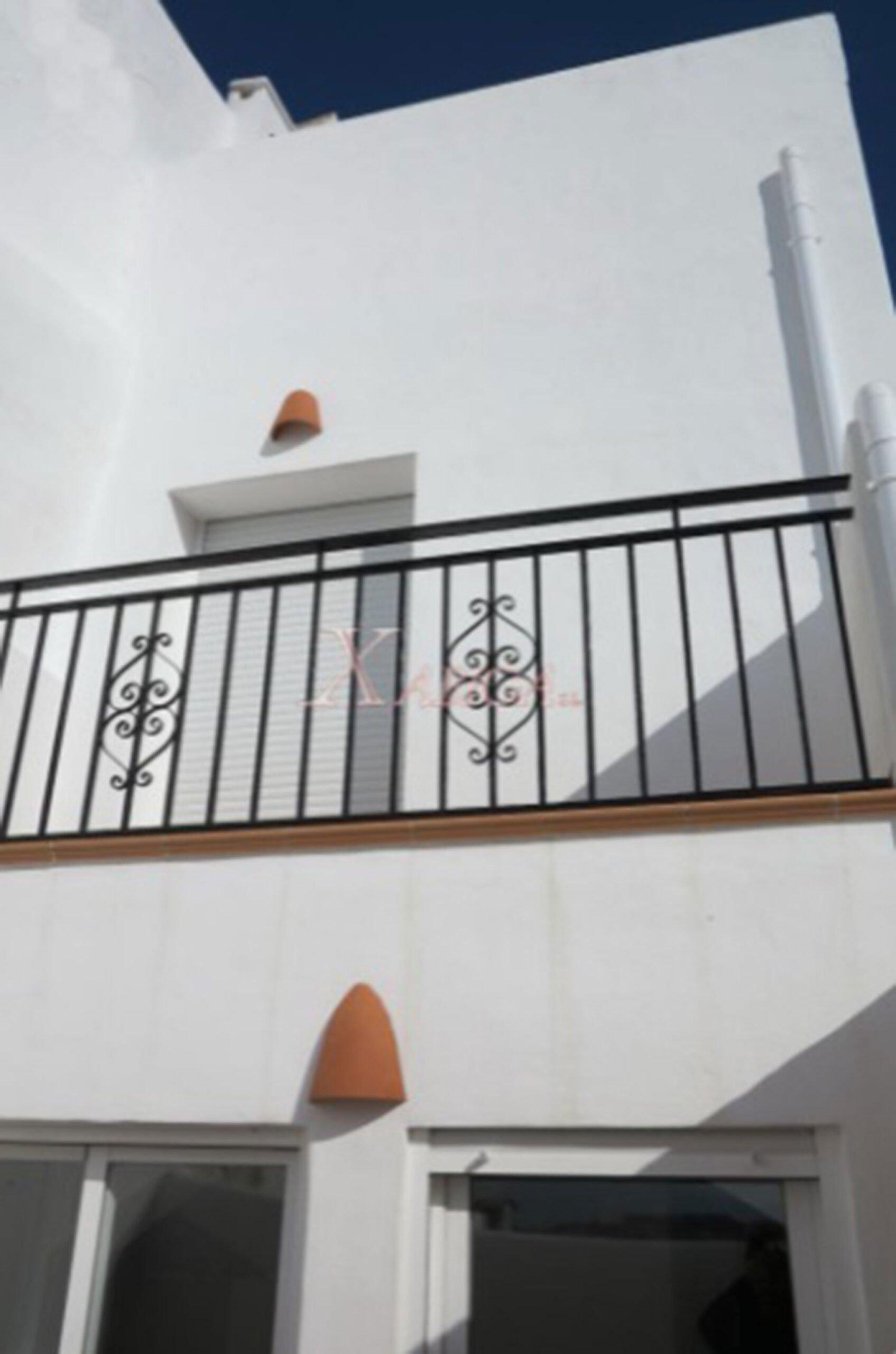 Balcón de una casa de pueblo en venta en Benitachell – Xabiga Inmobiliaria
